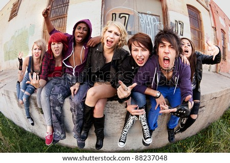 A group of angry young teens express themselves to the camera.