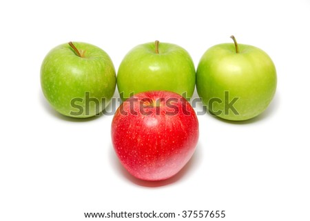 A group of apples with one red apple standing out from the crowd. Suitable for concepts such as outstanding, leadership qualities, individualistic, success, contrast, and striving for the top. - stock photo