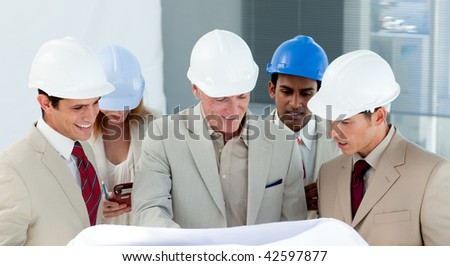A group of architect discussing a construction plan in a building - stock photo
