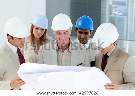 A group of architect discussing a project in a building - stock photo