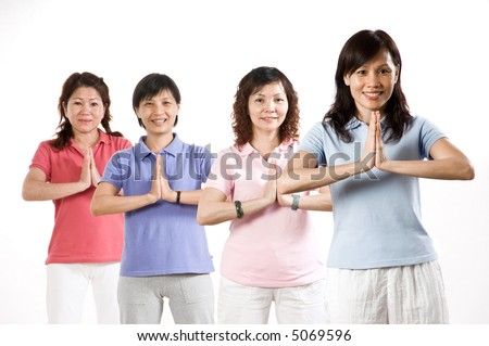 A group of Asian woman exercising in the studio on white background - stock photo