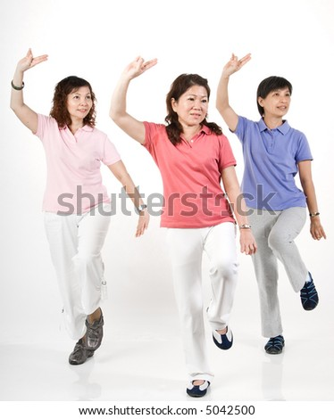 A group of Asian women exercising in the studio - stock photo
