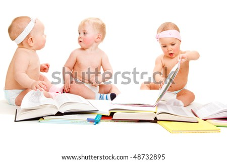 A group of beautiful babies reading books, isolated - stock photo