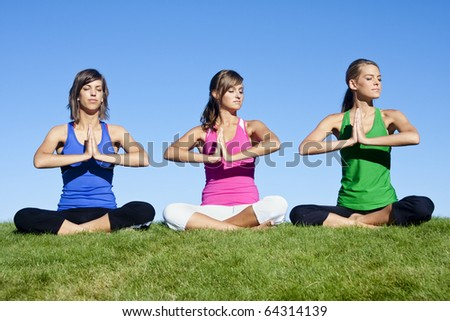 A group of beautiful young women doing yoga together