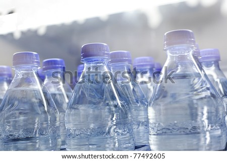 A group of blue water bottles