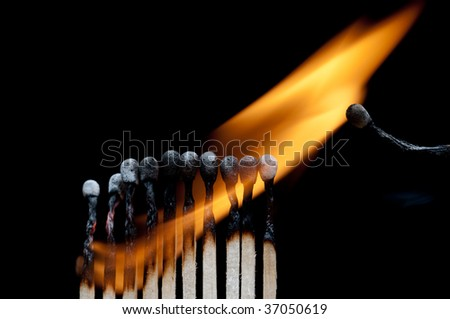 A group of burning matches on black - stock photo