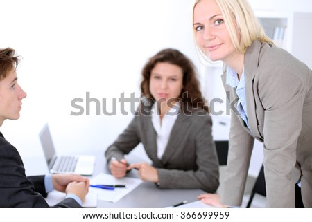 A group of business people at meeting