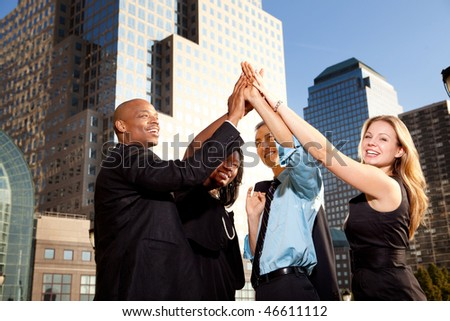 A group of business people happy and celebrating
