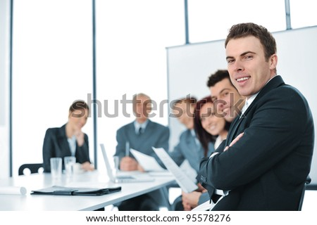 A group of business people  in a conference room