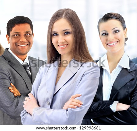 A group of business people in the office. - stock photo