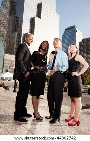 A group of business people looking out of the frame - future concept - stock photo