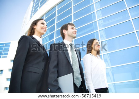 A group of business people on a background of a modern building