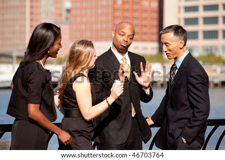 A group of business people outdoors in a discussion