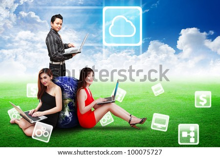 A group of business team present the Cloud icon on the blue sky on grass field : Elements of this image furnished by NASA