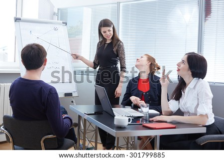 a group of businessmen in a meeting looking at the board