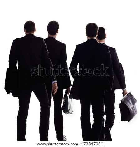 A group of businessmen on a white background. Urban scene.