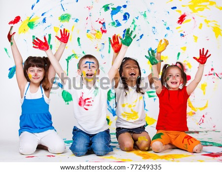 A group of cheerful kids with their palms and clothing painted