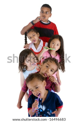 A group of children brushing thier teeth. - stock photo