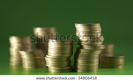 A group of coins on the green background