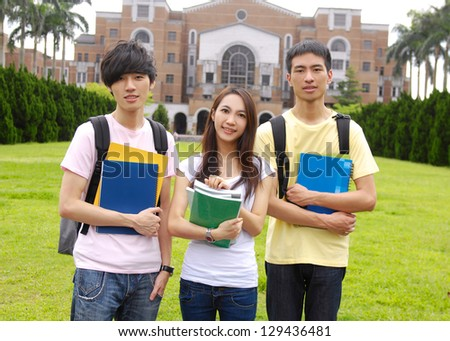 A group of college friends at a campus - stock photo