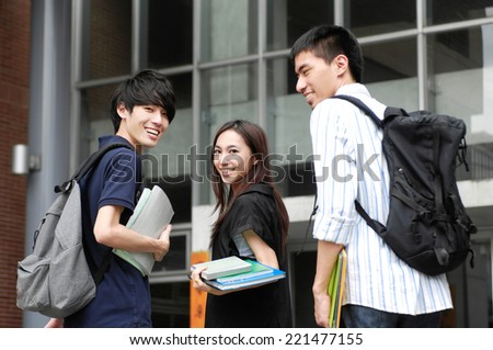 A group of college friends at his university at a campus - stock photo
