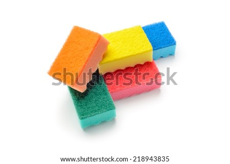 A group of colored kitchen sponges isolated on white background