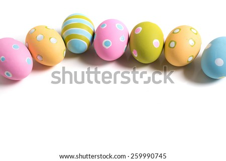 A group of colorful decorated Easter Eggs on a white background with copy space - stock photo