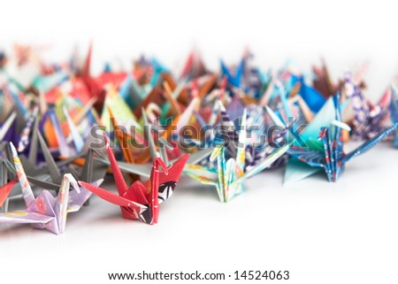 A group of colorful origami birds on a white background - stock photo