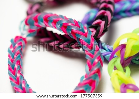 a group of colorful rubber band bracelets. - stock photo