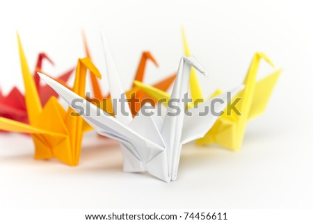 A group of colourful paper birds, shallow depth of field - stock photo