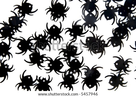 A group of confetti spiders on a white background