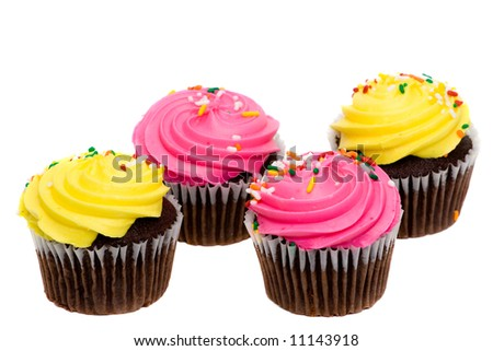 A group of cupcakes with pink and yellow frosting and sprinkles