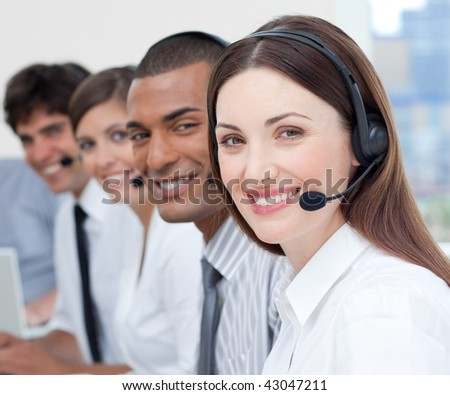 A group of customer service agents showing diversity in a call center - stock photo