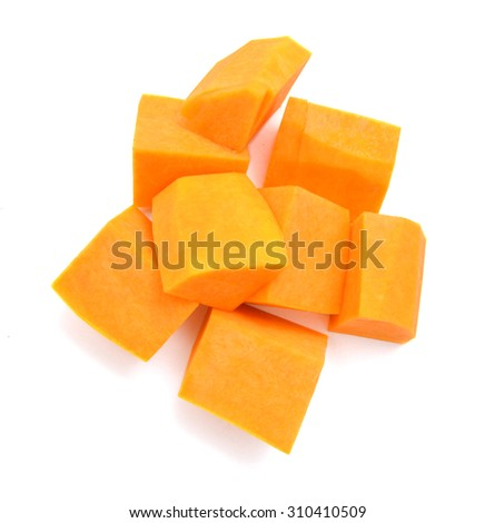A group of cut and slice butternut squash chunks on a white background. - stock photo