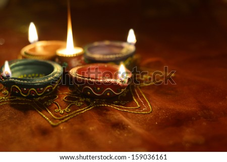 A group of decorative Indian Diwali lamps - stock photo