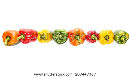 A group of different colorful capsicums over white background