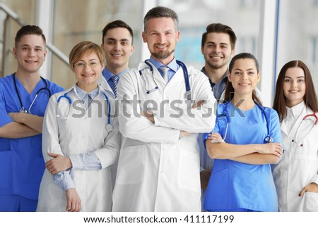 A group of doctors and nurses standing in the hospital - stock photo