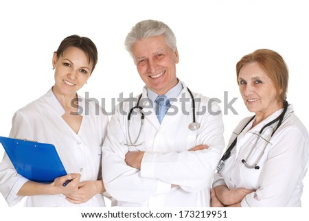 A group of doctors standing in office - stock photo