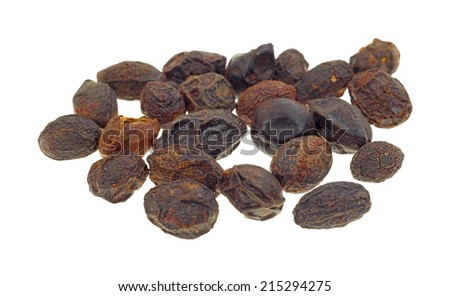 A group of dried saw palmetto berries on a white background. - stock photo