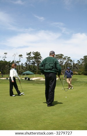 A group of elderly golfers on the golf course - stock photo