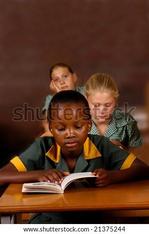 A group of elementary students reading in class - stock photo