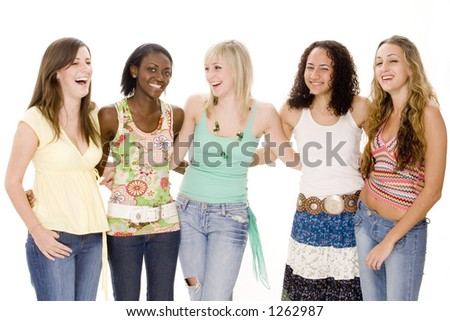 A group of five attractive young women share a laugh and joke