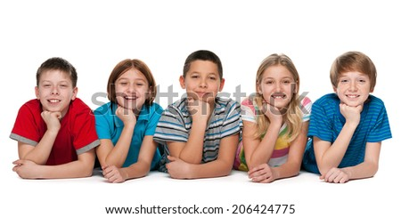 A group of five cheerful children are lying on the white background - stock photo