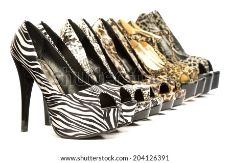 group of five high heels shoes in various animal print designs