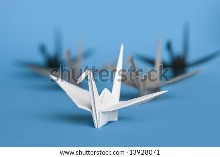 A group of five origami birds forming a v pattern - stock photo