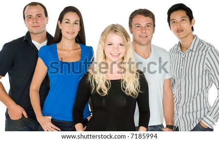 A group of five young adults standing together on white background