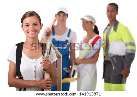 a group of four apprentices in the construction industry - stock photo