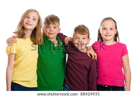 A group of four happy young kids wearing colorful shirts. - stock photo