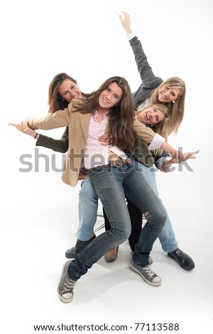 A group of four young women expressing joy