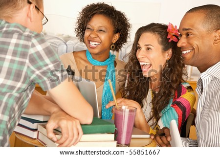 A group of friends are talking and smiling with each other.  Horizontal shot. - stock photo